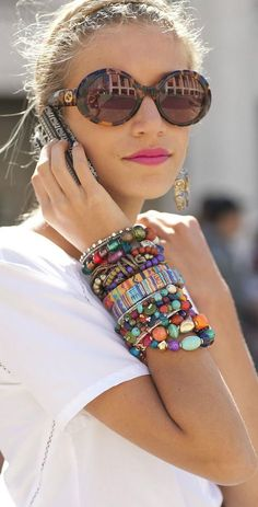 A stack of colourful bracelets make for some interesting arm candy. Just be sure it's too heavy for you to lift your arm up.