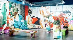 In person this room created by German visual artist Tobias Rehberger, looks like a wave of colourful abstract blocks and giant pixels. Currently on display at Art Basel Miami Beach and presented by the Swiss museum Fondation Beyeler, the installation is a kaleidoscope of colours, squares and unif...