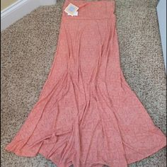 LuLaRoe Maxi NWT Absolutely stunning! NWT, size M. Can wear as a skirt or maxi dress! The first photo shows the color in natural light. ✨Price firm unless bundled✨ ✨Bundle & Save!✨ LuLaRoe Skirts Maxi