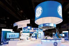 For the 2011 Offshore Technology Conference, 2020 Exhibits created a tech-driven booth for GE Oil & Gas that included touch-screen displays, video walls, a two-story meeting space, and a floating video ring. Exhibition Stall, Exhibition Booth Design, Exhibit Design, Trade Show Flooring, Exibition Design, Show Booth, Video Wall, Stand Design, Hanging Signs