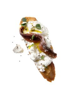 Baguette with ricotta, oregano, pepper, and optional anchovy, drizzeled with EVOO - Low Calorie Snacks - Redbook