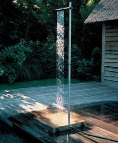 We need this outdoor shower at the lake cabin.  Such a good idea.