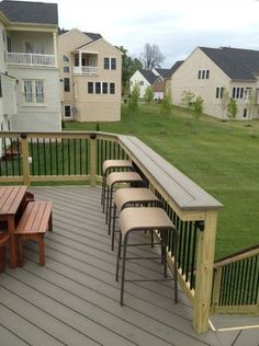 Love the idea of a railing bar in the backyard