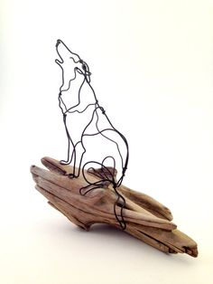 Howling Wolf wire animal sculpture on driftwood. by defildefer