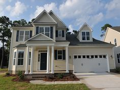 The Pamlico, 2885 SF featuring a downstairs master, 2 guest bedrooms upstairs and a bonus.