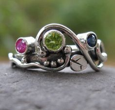 unique mother's ring. sterling silver and 3 birthstones . (( Wild Garden Mother's Ring )) . customized and made to order by bddesigns on Etsy https://www.etsy.com/listing/75743895/unique-mothers-ring-sterling-silver-and