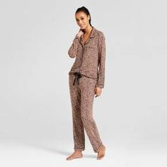 Playful details elevate the simple style of this Two-Piece Pajama Set from Gilligan & O'Malley™ for a pair you'll love adding to your sleepwear collection. The two-piece pajama set features an oh-so soft, smooth material and relaxed fit — perfect for wearing year-round as you move freely throughout the night. An animal print makes up the drawstring on the pants, along with accenting the cuffs, closure and pocket of the top. Getting ready to cuddle up for bed wil...