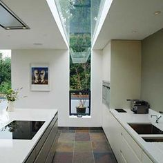 Good combination of sky light, wall art, space and modern kitchen #janeduncanarchitects