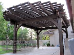Free standing pergola with Rich Cordoba stain and Crescent Step profile. Full wrap around roof and extended rafters on one side.