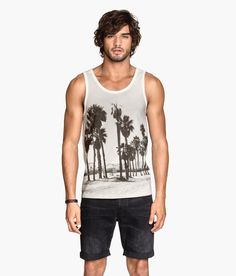 Transport yourself to Venice Beach, CA with this photographic palm tree tank top via H&M