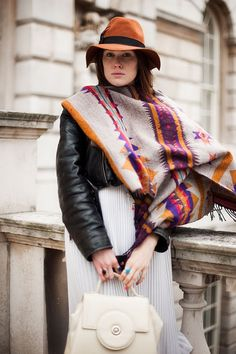 poncho, colors, and a black motorcycle jacket