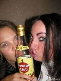 Duck Face: Origins Two girls kiss a bottle making double duck faces