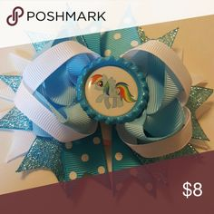 My Little Pony Hairbow Brand new. 4.5 inches.  Blue and white glitter hairbow comes on an alligator clip.   Bundle and save!  Spend  $50 before shipping and get a FREE gift! Accessories Hair Accessories