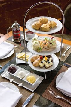 In the Park 75 Restaurant of the Four Seasons Hotel, your choice of tea is served with warm scones with freshly made raspberry jam, lemon cu...