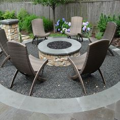 Backyard Patio Seating Area With Round Black Lava Fire Pit Landscaping