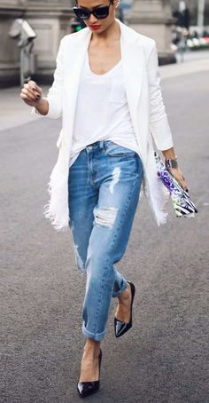 Micah Gianneli in the chicest weekend look with boyfriend jeans, white tee, and white feather blazer.