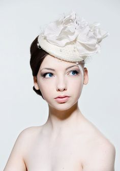 Ivory straw headpiece with large poppy and by RoseYoungMillinery, £155.00