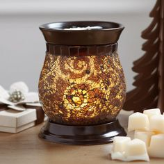 """Amaretto Swirl ScentGlow® Warmer  P90960   $45.00 Enjoy the Amaretto Swirl experience without the flame. Our electric warmer features a ceramic warming plate to diffuse the fragrance of Scent Plus® Melts, sold separately. A hidden LED light sets the swirls of crushed glass aglow. Black cord. 6""""h, 4¾""""dia.  Scent Plus® Melts"""