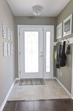 Simple but effective organisation for a small foyer - we would need shoe storage too!