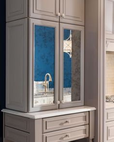 DESIGN TIP: Add sparkle without showing your wares- try our brand new Antique Mirage glass door insert!