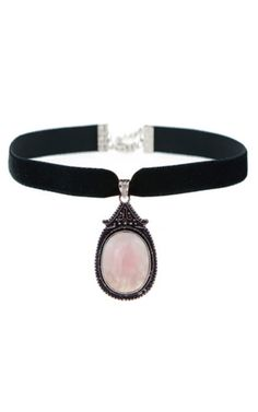 Semi-precious Rose Quartz gemstone pendant hangs from a velvet choker necklace.Rose quartz is the stone of the heart chakra, said to intensify love in relationships.