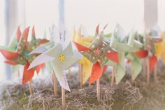 Pinwheel place cards for a spring wedding #placecards #realwedding