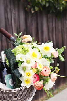 the perfect #spring pair, a bouquet of tulips and a bottle of pinot grigio
