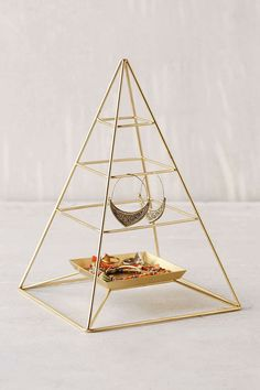 You're taking your fave accessories with you to college — don't lose them by just throwing them on your dresser! Store your fave baubles in a chic container that can double as dorm decor.   Magical Thinking Pyramid Jewelry Stand, $29, urbanoutfitters.com   - Seventeen.com