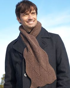 An intricate flame stitch pattern elevates this scarf from a simple winter staple to a stylish standout.