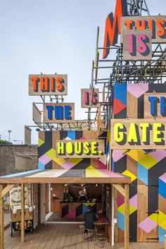 British artist Morag Myerscough designed the MVMNT Café, a temporary pop-up Café, which is part of the redevelopment of the Greenwich industrial estate in London, England. Environmental Graphics, Environmental Design, Cafe Design, Store Design, Design Design, Graphic Design, Pop Up Cafe, Wayfinding Signage, Event Signage