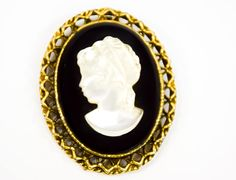 This wonderful Vintage cameo brooch is a lovely choice. It is great to wear with a lovely coat or on #vintage #vintagejewelry #sophisticatedjewelry #vintagebrooch #sophisticatedvintage #vintagevictorian #midcentury #midcenturyjewelry