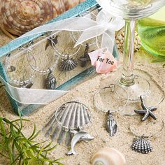 Beach Wine Charms: Ok, normally I would hate the cliche of the themed favors, but these are kind of cute!