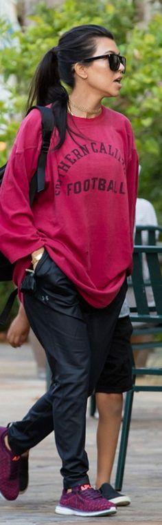 Kourtney Kardashian: Shoes – APL Athletic Propulsion Labs  Pants – Under Armour  Sunglasses – Saint Laurent  Bracelet – Cartier  Necklace – Lili Claspe  Shirt – USC