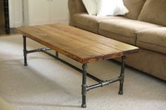 """Here's my new coffee table! I made the base from approximately $60 worth of 3/4"""" iron pipe and the top from three 4' long 2x8 pine boards (about $12 in lumber, and I still have another 4' foot board left over)."""