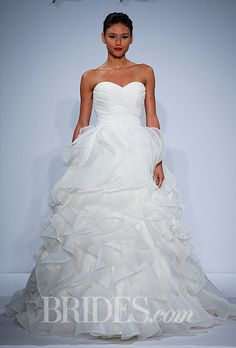 Brides.com: Dennis Basso for Kleinfeld - Spring 2014. Ivory wedding dress with sweetheart natural waist pleated bodice with A-line ruffled skirt, Dennis Basso
