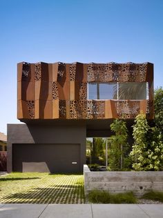 The sculpted and perforated exterior facade of the Walnut Residence by Modal Design is unique and artistic. This single family, 2,700 square foot home is located in Venice California