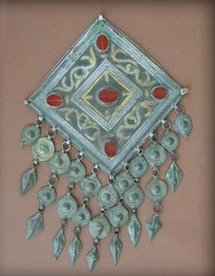 """Antique silver partially gilt Turkoman / Turkmen breast ornament """" Göndschük """" from North Afghanistan.   Good alloy of silver partially gilt and decorated with glass stones at the imitation of cornelians.   Early to mid 20th century."""