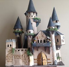 Inspired by a location in my story, I used cardboard, paper towel rolls, and foam board (all recycled of course) to construct my cardboard castle I've mad since I used paint and decorative moss to give it a… Cardboard Castle, Cardboard Crafts, Paper Crafts, Cardboard Paper, Cardboard Houses, Midevil Castle, Castle Crafts, Castle Project, Paper Towel Rolls