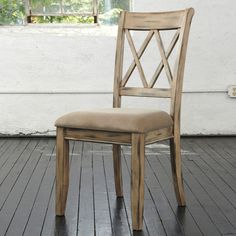 Stylish and comfortable, this antique white finished chair features a latticed back and cushioned seat, providing premium comfort. Give your home an idyllic aura with its textured, antiqued finish.