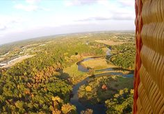 Flying over the Huron River in Island Lake State Park where the State of Michigan has created a special launch area for hot air balloons to launch.