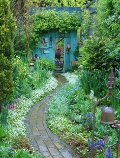 Love the path and the idea that a garden gate can be built to look like you are walking into a cute little cottage or shed, complete with windows, a false roof and window boxes.