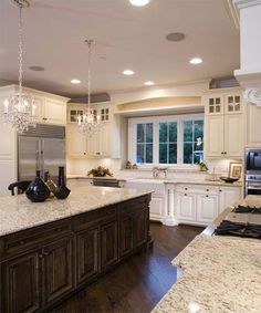 Kitchen with mix of dark wood and cream cabinets