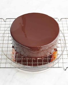"Gelatin is the key to a glistening chocolate glaze that stays put on your cake. Jacques Torres prepared this recipe with Martha on Episode 501 of ""Martha Bakes."""