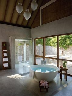 Three full bathrooms and one guest powder room, plus two outdoor garden showers in the Royal Beach Villa at Four Seasons Resorts Maldives at at Landaa Giraavaru