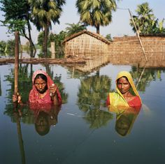 Photographer Gideon Mendel documented individuals affected by massive flooding in the UK, India, Haiti, Pakistan, Australia and Thailand as part of his on-going project titled Drowning World.