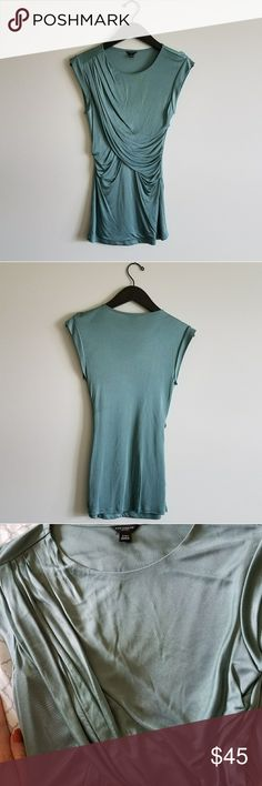 Teal Silky Sleeveless Blouse Super soft and silky top made with 100% rayon. It looks like there's a stain in the photos due to how the fabric captured on my phone but it's in perfect condition! (See the third photo which shows there's no stain.) Fits like a small or x-small. Worn to job interviews with a smart blazer, nice piece for a professional closet! Ann Taylor Tops Blouses
