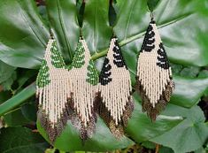 Split leaf details on hand-woven seed bead earrings. Leafy charm fringe is feather-soft and surprisingly lightweight! Dark or light green variations available. Part of the Eden collection. Ear hooks are lead and nickel safe. Bead Jewellery, Seed Bead Jewelry, Seed Bead Earrings, Jewelry Making Beads, Seed Beads, Jewelery, Bead Embroidery Patterns, Seed Bead Patterns, Bead Embroidery Jewelry