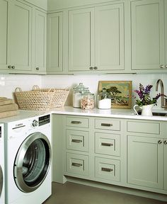 White subway tile & Light moss cupboards. I also like the old paint by numbers painting on the counter