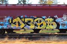 A D30$ train painted by Wyse spotted traveling fast down the tracks.