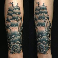 Traditional ship tattoo on both legs
